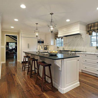 white corbels white kitchen cabinets black and white granite countertops